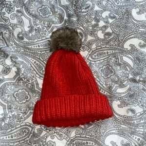 Orange puff ball hat